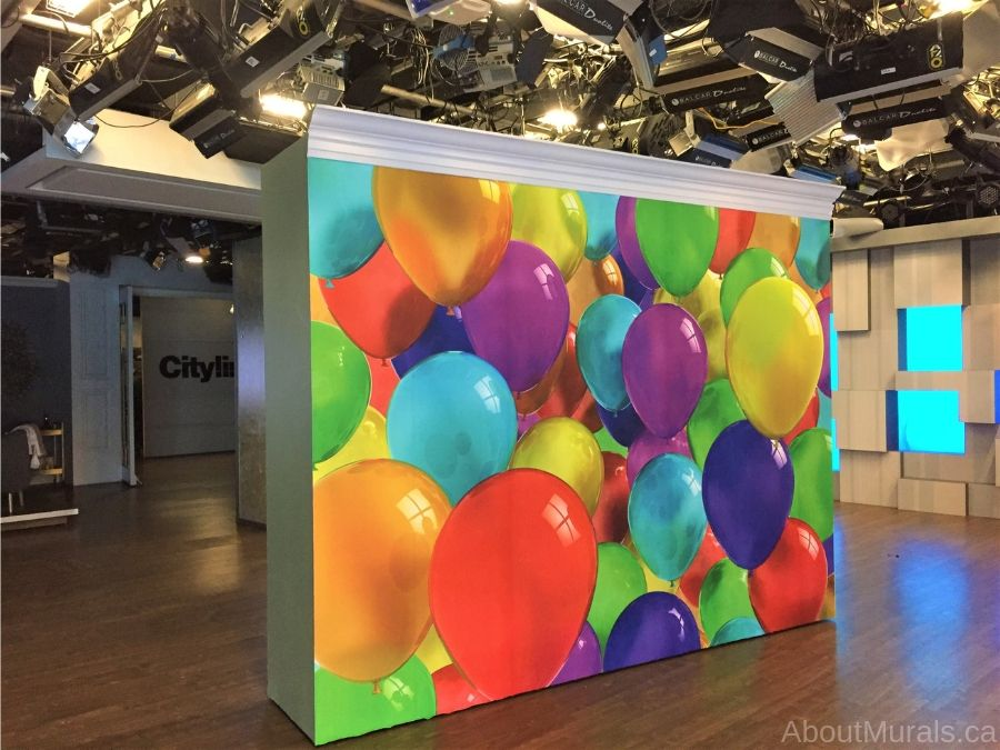 A party room wallpaper on set at Cityline features rainbow coloured balloons. Sold by AboutMurals.ca