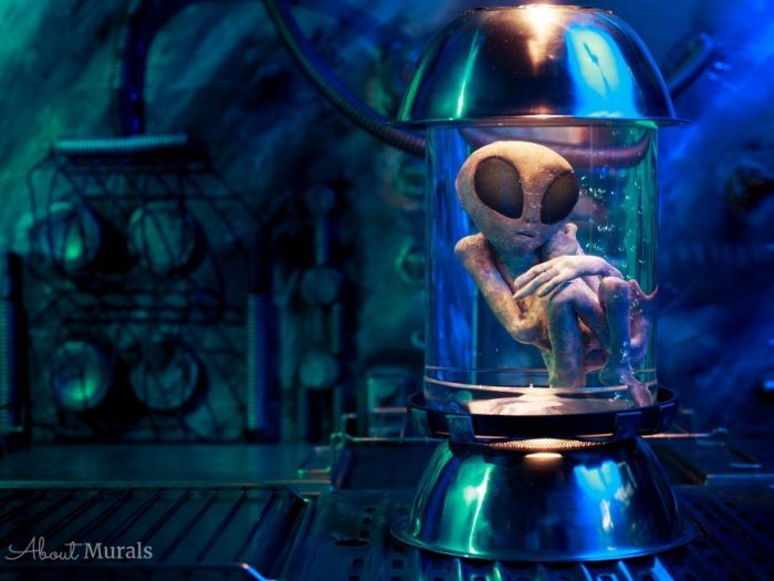 An alien mural featuring an extra-terrestrial in a lab jar, printed on removable wallpaper.