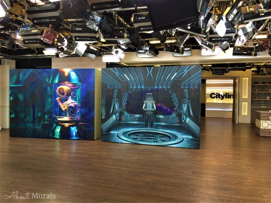 An alien mural, as seen on set at Cityline, features an extra-terrestrial floating in a lab jar.