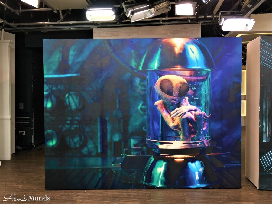 An alien mural featuring an extra terrestrial in a specimen jar from AboutMurals.ca