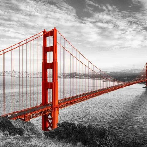 A removable wallpaper of a red Golden Gate Bridge against a black and white photograph of the San Francisco landscape. Removable wallpaper from AboutMurals.ca