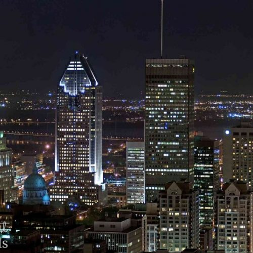 A view of shimmering skyscrapers in downtown Montreal at night. Removable wallpaper from AboutMurals.ca