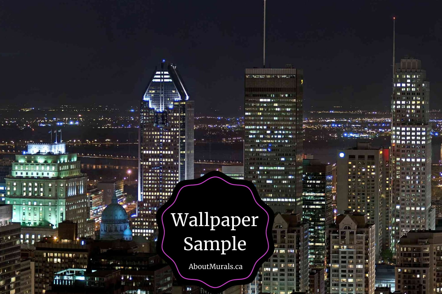 """Skyscrapers tower over downtown Montreal at night with the words """"Wallpaper Samples Available from AboutMurals.ca"""""""