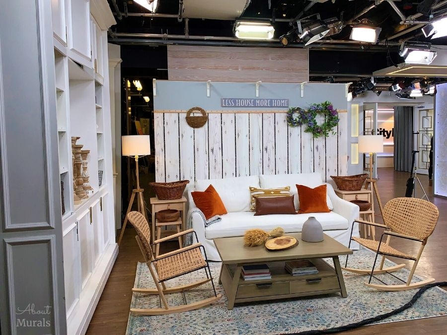 A farmhouse wallpaper is the backdrop to a farmhouse living room on set at Cityline, from AboutMurals.ca